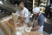 Mike Humphrey and Edward Norlin prepare pizza dough at Limestone Pizza, 814 Massachusetts St., Lawrence's newest pizza place serving Neapolitan-style prairie-made pizza.