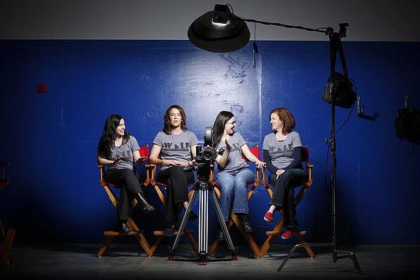 The founding members of the Women of Lawrence Film, or WOLF, from left, Marlo Angell, Laura Kirk, Misti Boland and Christie Scanlin Dobson are pictured at Through A Glass production studio, 720 E. Ninth St. The group of local filmmakers came together to mentor young women while making a series of short films.