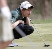 Free State golfer Jack Junge lines up a putt Wednesday at Eagle Bend during the Free State High School Invite golf tournament.