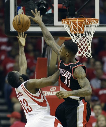 Houston Rockets' James Harden (13) has his shot blocked by Portland Trail Blazers' Thomas Robinson (41) during the first half in Game 2 of an opening-round NBA basketball playoff series Wednesday, April 23, 2014, in Houston. (AP Photo/David J. Phillip)