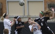 From left, Lawrence High's Addison Campbell, Free State's Olivia Hodison, Lawrence High's Gretchen Hierl and Free State's Jessica Ferguson go after the ball during the soccer city showdown on Thursday, April 24, 2014, at LHS.