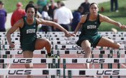 Free State's Gabbi Dabney, left, and Kiara Clark run 1-2 in the prelims in the 100-meter hurdles on Friday, April 25, 2014, at FSHS.