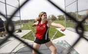 Lawrence High's Rebecca Finley prepares to throw the discus on Friday, April 25, 2014, at Free State High.
