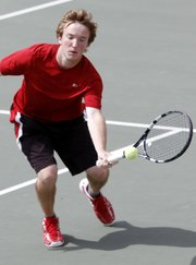 Lawrence High's Thomas Irick plays a ball near the net during an LHSl tennis Invitational Friday at LHS.