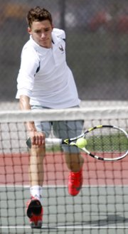 Free State's Ian Pultz-Earle competes in his No. 1 singles match Friday at Lawrence High.