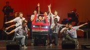 For the act, in which students dressed as car mechanics sang the song GTO by Ronny and the Daytonas, a shell in the shape of a GTO car was fitted over Alex's wheelchair.