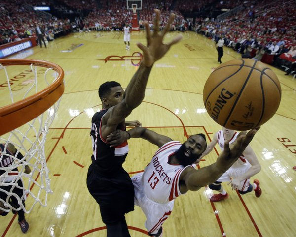 Houston Rockets' James Harden (13) put sup a shot against Portland Trail Blazers' Thomas Robinson (41) during the first half in Game 2 of an opening-round NBA basketball playoff series Wednesday, April 23, 2014, in Houston. (AP Photo/David J. Phillip)