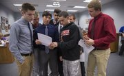 Lawrence High School basketball team members attend the Lawrence school board meeting Monday to show their support for basketball coach Mike Lewis, who was recently fired from his coaching position. The boys all gave speeches in Lewis' favor. From left, they are Noah Hogan, Jackson Mallory, Ben Rajewski, Fred Brou, Kaustubh Nimkar (partially hidden), Anthony Harvey, Kyle Hoffman, Price Morgan.