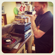 Brad Shanks of Blood on the Wall listens to a record at Love Garden. Photo courtesy of Love Garden on Instagram.