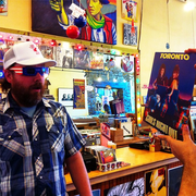 Kelly Corcoran, owner of Love Garden Sounds, testing out a 3D record cover. Photo courtesy of Love Garden on Instagram.