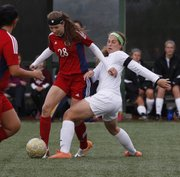 Free State's Jessica Ferguson (6) tries for a steal on Olathe North's Taylor Wolfe in the Firebirds' 2-0 victory Thursday, May 1, 2014, at FSHS.