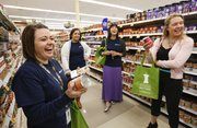 During a grocery store tour Thursday at Dillons, 1015 W. 23rd St., Jolene Croxell of the Lawrence-Douglas County Health Department and other participants react with surprise when discovering the sodium content of some canned vegetables. Pictured clockwise to the right of Croxell are health department AmeriCorps members Beeta Kashani and Amanda Kong, and Kelsey Fortins, a health educator at Kansas University's Watkins Memorial Health Center.