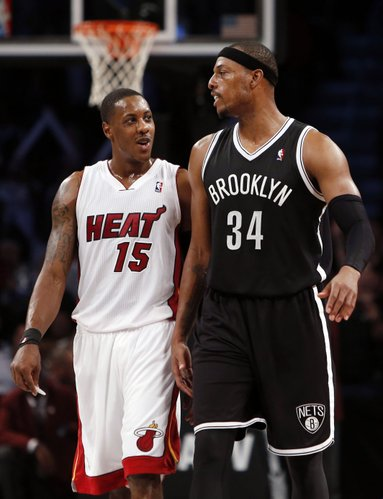 Miami Heat's Mario Chalmers (15) exchanges words with Brooklyn Nets' Paul Pierce during an NBA basketball game Friday, Nov. 1, 2013, in New York. Brooklyn won 101-100. (AP Photo/Jason DeCrow)