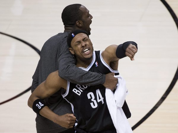 Brooklyn Nets forward Paul Pierce (34) reacts with teammate Andray Blatche, right, after defeating the Toronto Raptors in Game 7 of the opening-round NBA basketball playoff series in Toronto, Sunday, May 4, 2014. (AP Photo/The Canadian Press, Nathan Denette)