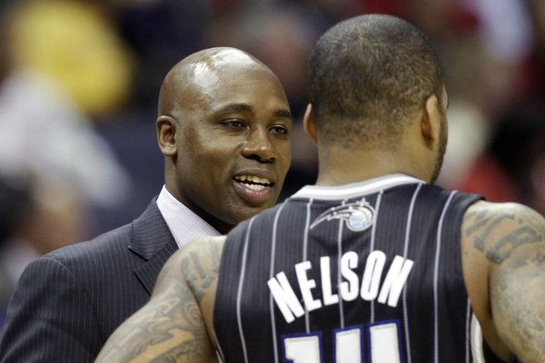 Orlando Magic coach Jacque Vaughn, left, talks to Orlando Magic's Jameer Nelson in the second half of an NBA basketball game in Memphis, Tenn., Monday, Dec. 9, 2013. The Grizzlies defeated the Magic 94-85. (AP Photo/Danny Johnston)
