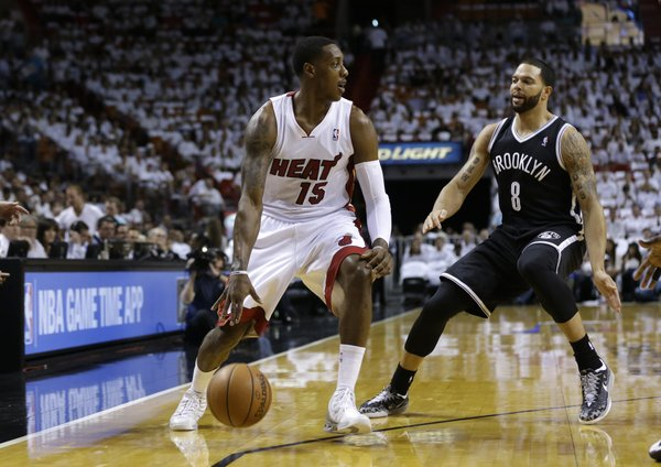 Miami Heat's Mario Chalmers (15) drives to the basket as Brooklyn Nets' Deron Williams (8) defends in the first half of Game 1 in an Eastern Conference semifinal basketball game, Tuesday, May 6, 2014, in Miami. (AP Photo/Lynne Sladky)