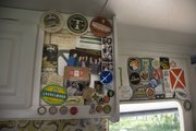 Maria Scarpello and Brian Devine's RV is wallpapered with beer labels from the many places they've traveled.
