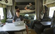 Maria Scarpello and Brian Devine 31 live and work in their 29-foot 1999 Ford Jayco Class C motorhome.