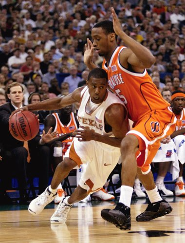 Texas' T.J. Ford drives on Syracuse's Josh Pace in the first half of a semifinal game of the Final Four on Saturday, April 5, 2003, in New Orleans. (AP Photo/Michael Conroy)