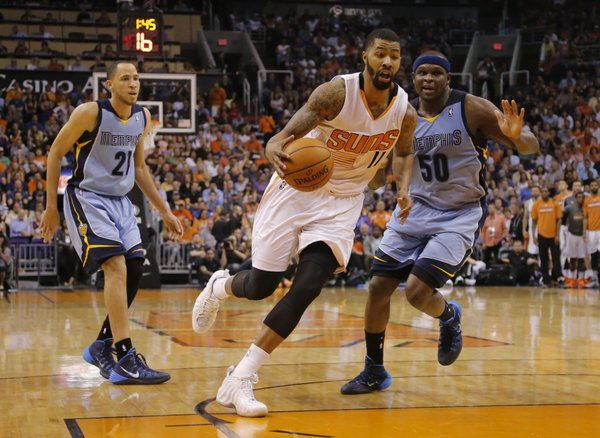 Phoenix Suns' Markieff Morris (11) drives as Memphis Grizzlies' Zach Randolph (50) and Tayshaun Prince (21) defend during the second half of an NBA basketball game, Monday, April 14, 2014, in Phoenix. The Grizzlies won 97-91. (AP Photo/Matt York)