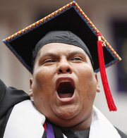 "Haskell graduate Leander Blane Loretto, from Jemez Pueblo, New Mexico, sings ""Onward Haskell"" at the end of the commencement ceremony on Friday at Coffin Sports Complex."