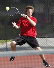 Lawrence High's Thomas Irick returns a shot during his regional championship Saturday, May 10, 2014, at the LHS courts.