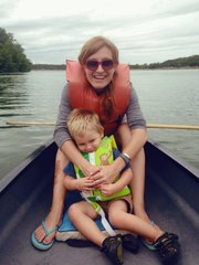 Meryl Carver-Allmond and her son ride a canoe at Shawnee Mission Park last summer, one of the activities on the family's summer bucket list.