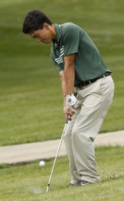 Free State's Jack Flynn chips onto the green at the LHS Invite on Wednesday, May 14, 2014, at Alvamar.