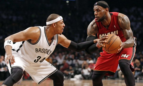 Brooklyn Nets forward Paul Pierce (34) defends Miami Heat forward LeBron James (6) in the second half of Game 4 of their second-round NBA playoff basketball game at the Barclays Center, Monday, May 12, 2014, in New York. James tied a career playoff scoring record with 49 points as the Heat defeated the Nets 102-96 going up 3-1 in the best of seven series. (AP Photo)