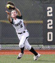 Free State junior Emily Bermel makes a tough catch in the Firebirds 4-3 win over Lawrence High school Wednesday at FSH.