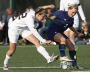 Free State senior Rosemary Newsome (22) tries to force the ball from Topeka Hayden's Margaret Dunshee (2) on Thursday at FSHS. The Firebirds won, 2-1.