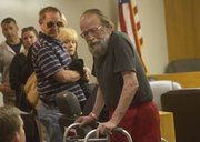 Larry Hopkins, right, leaves a Douglas County courtroom Thursday after being sentenced to life in prison for the shooting death of his wife, Margaret Hopkins, in November 2013. Hopkins read a statemement Thursday detailing his wife's ailments. In the background are family and friends of Hopkins, including his sister, Melissa Quigley, second from right.
