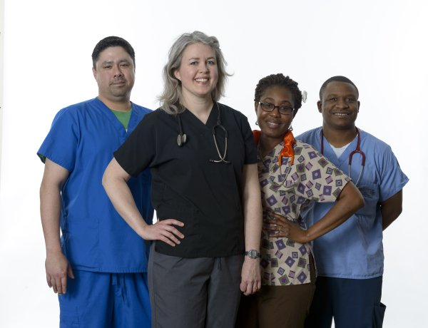 Because of a ripple effect, for each job at Lawrence Memorial Hospital, another 0.59 job is created in Douglas County. Pictured are Sean Stubbs, Sonya Schinkel, Naa Britwum and Clifton Sims, who work on the fourth floor at LMH.