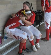 Lawrence High freshman Mikayla Lockwood, right, consoles senior Andrea Mills after the Lions' regional softball loss to Topeka High on Tuesday, May 20, 2014, in Olathe.