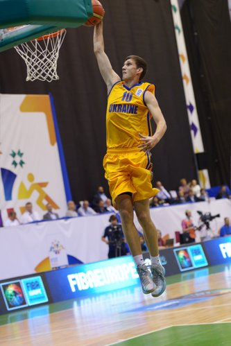 Sviatoslav Mykhailiuk of Ukraine competes during the U16 Eurobasket 2013 first-round match between Ukraine and Latvia at Palace of Sport in Kiev, Ukraine, on Aug. 8, 2013.