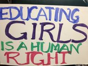 "A sign in Kansas University professor Beverly Mack&squot;s office reads, ""Educating girls is a human right."" The sign was part of a demonstration in downtown Lawrence to raise awareness of the more than 250 Nigerian girls kidnapped by militant group Boko Haram."