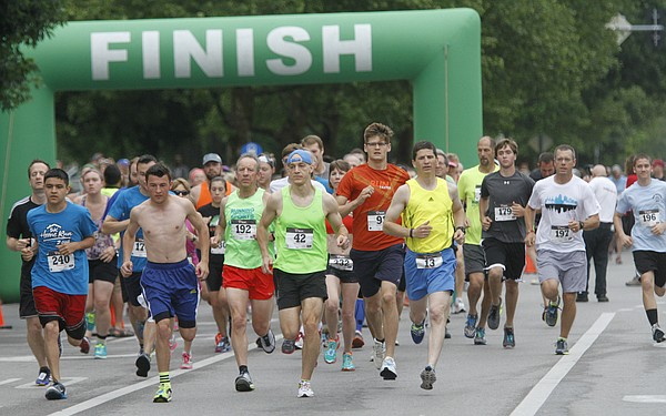 Runners start the 2nd Annual Home Run 5K Monday morning, May 26, 2014. The run through downtown and into East Lawrence benefits th Lawrence Community Shelter and Family Promise of Lawrence.