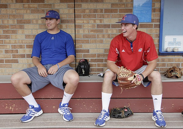 Senior pitchers Frank Duncan, left, and Jordan Piché relax before practice shortly after the Jayhawks found out they made it into the NCAA Tournament and will play University of Kentucky in Louisville, Kentucky, on Friday, May 30, 2014.