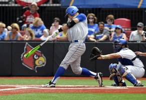 Kansas' Connor McKay, center, hits a foul against Kentucky during an NCAA college baseball regional tournament game in Louisville, Ky., Friday, May 30, 2014. Catching is Kentucky's Michael's Thomas. (AP Photo/Timothy D. Easley)
