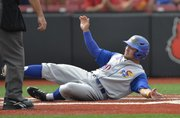 Kansas University's Justin Protacio slides into home to score a run in the second inning of the Jayhawks' 10-6 victory over No. 22 Kentucky in an NCAA Tournament game Friday in Louisville, Kentucky.