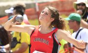 Lawrence High's Matia Finley competes in the girls shot put at the Class 6A track and field meet Saturday in Wichita.