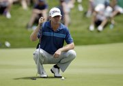 Chris Thompson prepares to putt on the 17th green during the third round of the Byron Nelson Championship golf tournament, Saturday, May 17, 2014, in Irving, Texas. (AP Photo/Tony Gutierrez)