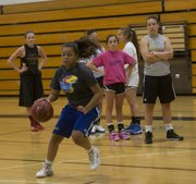 Free State senior Lexci Kimball works on dribbling moves at camp Wednesday, June 4, 2014, at Southwest Middle School.