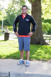 Clothing details: Nike shoes, $90; KU shirt, $50; KU sweatshirt, $35; shorts, $60.