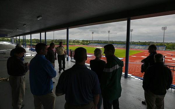City employees, Parks and Recreation advisory board members and guests get a tour of the 6,500-seat Kansas University track and field facility during a tour of Rock Chalk Park, Tuesday, June 10, 2014.