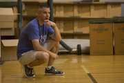 Free State boys basketball coach Chuck Law watches campers Wednesday at FSHS.