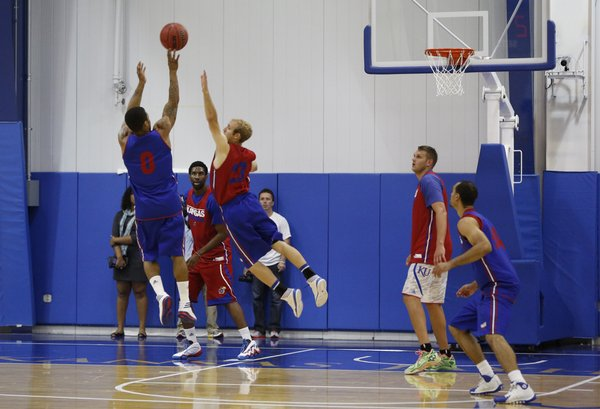 Red Team guard Conner Frankamp lunges to defend against a shot from Blue Team guard Frank Mason during a scrimmage on Wednesday, June 11, 2014 at the Horejsi Center.