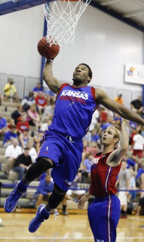 Blue Team guard Wayne Selden soars in for a dunk past Red Team guard Conner Frankamp during a scrimmage on Wednesday, June 11, 2014 at the Horejsi Center.