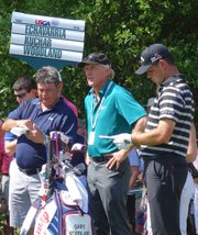 Former PGA Tour standout Greg Norman, center, consults with Kansas University alumnus Gary Woodland, right, and Woodland's caddie, Tony Navarro, left, during a U.S. Open practice round Wednesday, June 11, 2014, in Pinehurst, North Carolina.