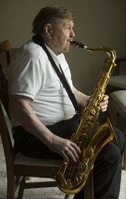 Clyde Bysom, 96, is an active musician in Lawrence and can be seen performing with the Junkyard Jazz Band, the New Horizons Senior Band and Clarinet Quartet, though he has memories of many bands all the way back to World War II.
